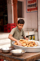 Boy prepares his delicacies for sale